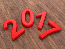 3D rendering 2017 New Year red digits. Lying on a wooden surface Stock Image
