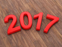 3D rendering 2017 New Year red digits. Lying on a wooden surface Royalty Free Stock Photos