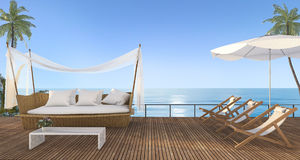3d rendering nice beach rattan sofa with beach bed on terrace near sea with morning scene Royalty Free Stock Images