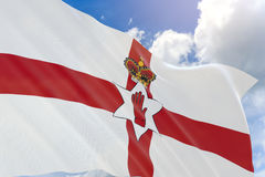 3D rendering of Northern Ireland flag waving on blue sky Stock Photos