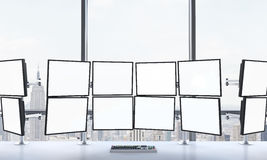 3D rendering of office with blank monitors Royalty Free Stock Image