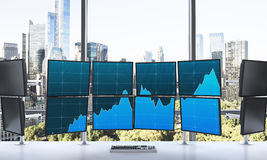 3D rendering of office with switched on monitors, processing dat. A for trading, window at the background, new york Stock Photos