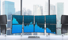 3D rendering of office with switched on monitors, processing dat. A for trading, window at the background, singapore Stock Images