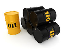 3D rendering oil barrels. 3D rendering Black and yellow metal oil barrels on white background Stock Photo