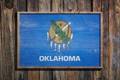 Wooden Oklahoma flag. 3d rendering of a Oklahoma State USA flag on a wooden frame and a wood wall Stock Photography