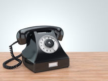 3D rendering old black phone. On the table Royalty Free Stock Photography
