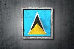 Saint Lucia flag in concrete wall Stock Photo