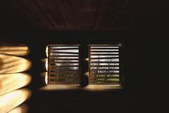 Old wooden cabin with sunlight through window. 3d rendering of old wooden cabin with sunlight through window Royalty Free Stock Image