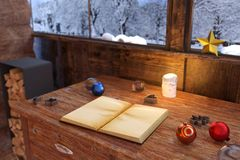 3d rendering of open book on wooden vintage table at wooden hous. E with christmas decoration Stock Images