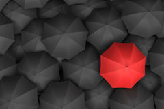 3d rendering of open bright red umbrella towering over an endless amount of similar black umbrellas. Unique outlook. Bright idea. Different opinion Stock Photography