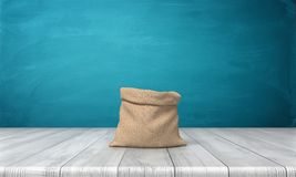 3d rendering of an open money bag made of hessian cloth with no markings standing on a wooden desk on blue background. Open your account. Receive monetary stock photo