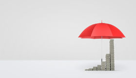 3d rendering of an open red umbrella on white background covering several stacks of money placed as a growing graph. Stock Photos