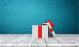 3d rendering of a open white gift box with a red bow standing on a wooden desk. In front of a blue background. Gifts and surprises. Special bonus. One time Royalty Free Stock Photos