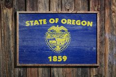 Wooden Oregon flag. 3d rendering of a Oregon State USA flag on a wooden frame and a wood wall Stock Images