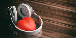 3d rendering pair of wireless headphones and a red heart Royalty Free Stock Photo