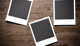 Photo Frames On Wooden Background Closeup. 3D Rendering Of Photo Frames On Wooden Background Closeup Royalty Free Stock Images