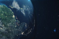 3D Rendering Planet earth from the space at night. The World Globe from Space in a star field showing the terrain and. Clouds Elements of this image furnished Stock Photo
