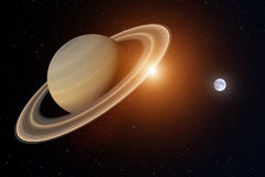 3d rendering from the planet saturn with the earth and sun in the background, elements of this image are furnished by NASA Royalty Free Stock Image