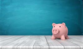 3d rendering różowy prosiątko bank w frontowego widoku pozyci na drewnianym stole Zdjęcia Royalty Free