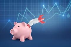 3d rendering rakietowy karambolowanie z prosiątko bankiem na błękitnym graficznym tle obrazy stock