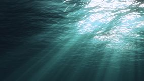 3D rendering of underwater light creates a beautiful solar curtain. Underwater ocean waves oscillate and flow with the rays of lig. 3D rendering of rays of stock photos