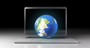 Realistic Planet Earth Globe Over Laptop Keyboard royalty free illustration