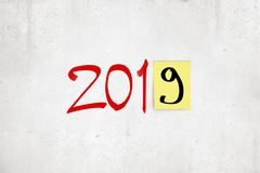 3d rendering of `2019` red marker sign with black `9` on post-it yellow note on white background royalty free illustration
