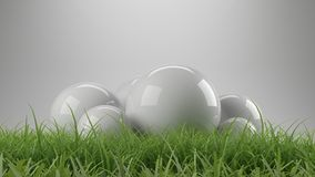 3d rendering of reflective spheres with grass Stock Images