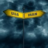 Road arrow sign. 3d rendering of road signs with USA and IRAN text pointing in opposite directions. Image relative to politic situation between USA and Iran Stock Image