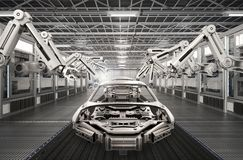 Robot assembly line in car factory Stock Photos