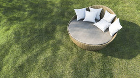 3d rendering round outdoor sofa in the grass field Stock Image