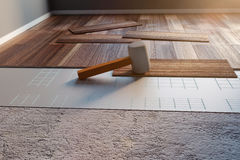 3d rendering of rubber hammer laying on laminate panels. 3d rendering of hammer laying on laminate panels Royalty Free Stock Photo