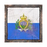 Old San Marino flag. 3d rendering of a San Marino flag over a rusty metallic plate wit a rusty frame. Isolated on white background Royalty Free Stock Images