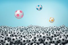 3d rendering of sea of identical black and white soccer balls with three balls of bright colors flying above it. royalty free illustration