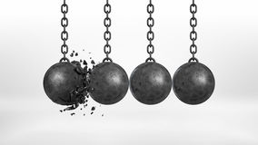 3d rendering of a set of four black iron wrecking balls handing from their chains where one ball is broken. Stock Photos