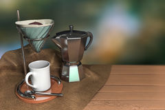 3d rendering a set of vintage coffee drip on a wooden table. With burlap and green dark bokeh background Stock Photos