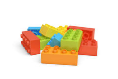 3d rendering of several colorful LEGO bricks lying on white background. Royalty Free Stock Photo