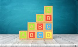3d rendering of a several toy blocks with letters A, B, C and D in a stairs shape on a wooden table. Learning to read. Construction blocks. Learning and Royalty Free Stock Photo
