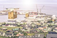 Drone flying above town. 3d rendering of shipping cargo drones on town royalty free stock photo