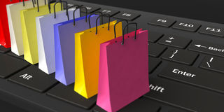 3d rendering shopping bags on a keyboard. 3d rendering shopping bags on a black keyboard Royalty Free Stock Image