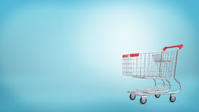 3d rendering of a shopping cart with a red handle  on blue background. Sales and promotions. Grocery shop and supermarket. Going shopping Stock Photography
