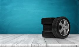3d rendering of a single car tire leaning on three tires standing on a wooden surface in front of blue background. Spare wheels. Car service. Changing Stock Images