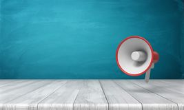 3d rendering of a single red and white megaphone hanging vertically above a wooden desk. Public speaker. Attention. Emergency and disaster information Stock Image