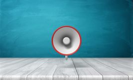 3d rendering of a single red and white megaphone hanging vertically above a wooden desk. Public speaker. Attention. Emergency and disaster information Stock Photo
