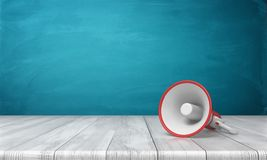 3d rendering of a single red and white megaphone lying down on a wooden desk on blue background. Public speaking. Sound equipment. News and announcements Stock Photo