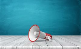 3d rendering of a single red and white megaphone lying down on a wooden desk on blue background. Public speaking. Sound equipment. News and announcements Royalty Free Stock Photo
