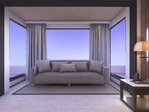 3d rendering sofa in living room with sea view in twilight Royalty Free Stock Photo