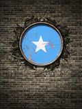 Old Somalia flag in brick wall. 3d rendering of a Somalia flag over a rusty metallic plate embedded on an old brick wall stock photos