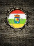Old La rioja flag in brick wall. 3d rendering of a Spanish La rioja community flag over a rusty metallic plate embedded on an old brick wall Royalty Free Stock Image