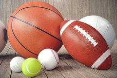 3d rendering sport balls on wooden backgorund. Set of sport balls. Sport equipment such us football, basketball. Baseball, tennis, golf ball for team and Royalty Free Stock Photography